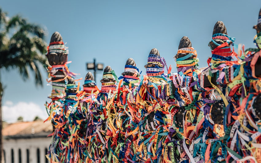 Fence of colorful ribbons at Bomfim church in Salvador
