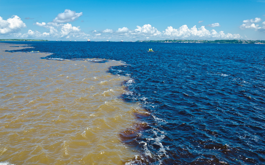 The Black River (Rio Negro) and Amazon River (Rio Amazonas) meet each other near Manaus City